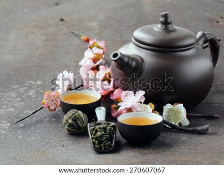 tea set (teapot, cups and different green tea) - stock photo