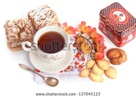 Tea Time. Still life with cup of tea and pastry. - stock photo