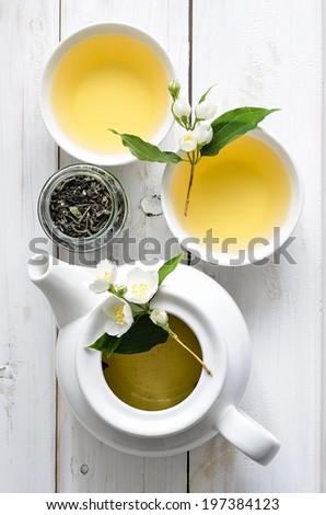 Tea with jasmine flowers - stock photo