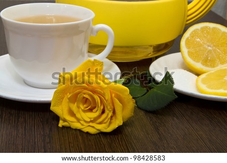 Tea with lemon and yellow rose. - stock photo