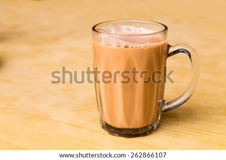 Tea with milk or popularly known as Teh Tarik in Malaysia - stock photo