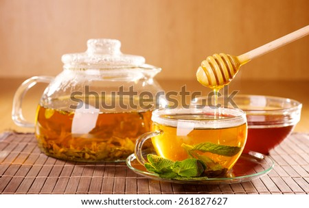 tea with mint and honey - stock photo