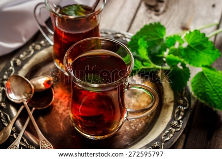 tea with mint in the Arab style on wooden table.Selective focus. - stock photo