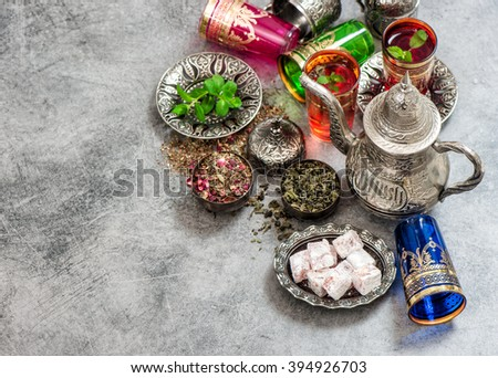 Tea with mint leaves and rose flower petals. Oriental hospitality concept. Holidays table setting. Ramadan kareem - stock photo