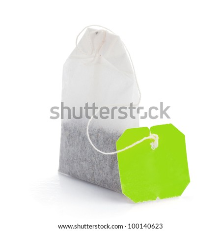 Teabag with green label. Isolated on white background - stock photo