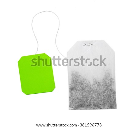 Teabag with green label isolated on white background - stock photo