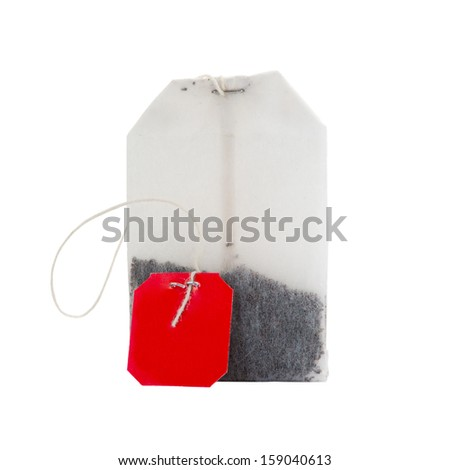 Teabag with red label isolated on a white - stock photo