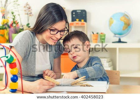 Teacher and Child Playing And Learning at Classroom - stock photo
