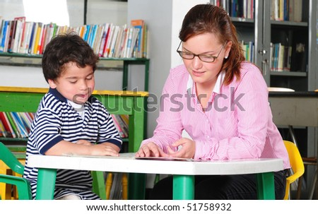 Teacher and preschooler. - stock photo