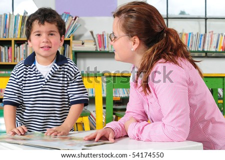 Teacher and student. - stock photo