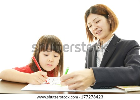 Teacher and Student in A Classroom At School - stock photo
