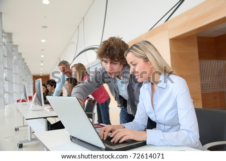 Teacher and student in training course at school - stock photo