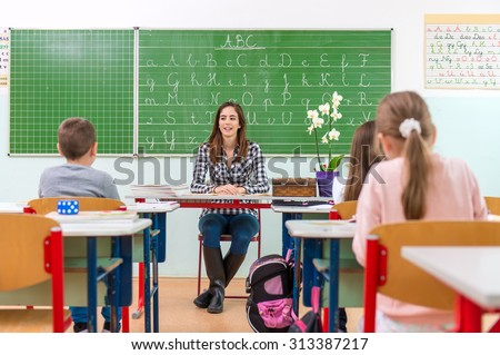 Teacher and students in the classroom: teaching, - stock photo