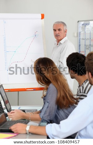 Teacher at front of class - stock photo