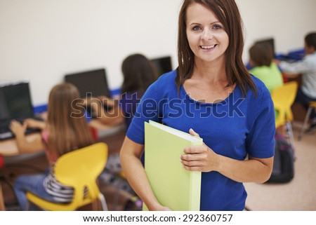 Teacher during the science computer lesson - stock photo