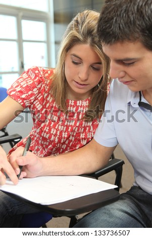 teacher helping a student - stock photo