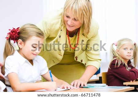 Teacher helps to solve the problem - stock photo