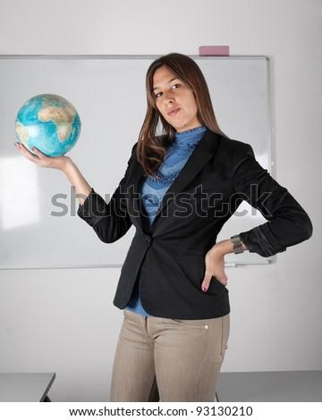 Teacher holding globe in hand - stock photo