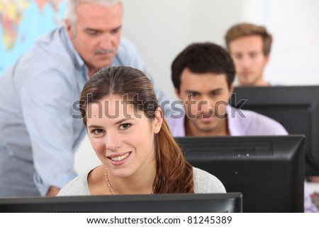 teacher lesson at students technology - stock photo