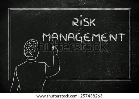 teacher (or ceo) writing on blackboard explaining about risk management - stock photo