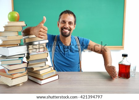 """Teacher showing thumbs up and hand gesture no: """"Yes Education - No Alcohol"""". Photo adult teacher in classroom, education concept - stock photo"""