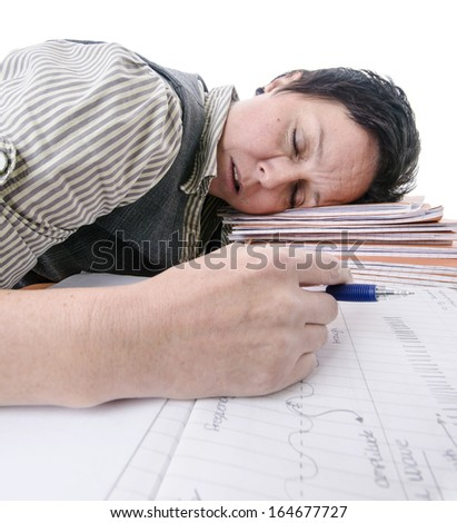 teacher / student sleeping on pile of books - stock photo