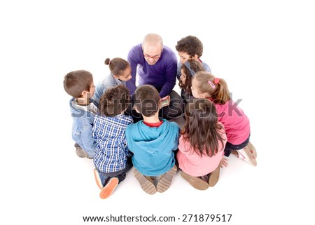 teacher telling a story to kids isolated in white - stock photo