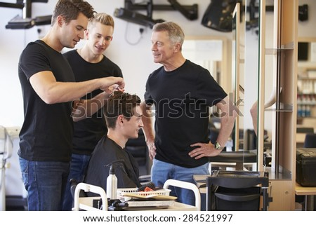 Teacher Training Mature Students In Hairdressing - stock photo