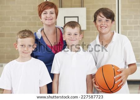 Teacher With Boys School Basketball Team - stock photo