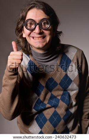 teacher with funny glasses, studio picture - stock photo