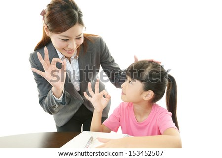 Teacher with girl studying. - stock photo