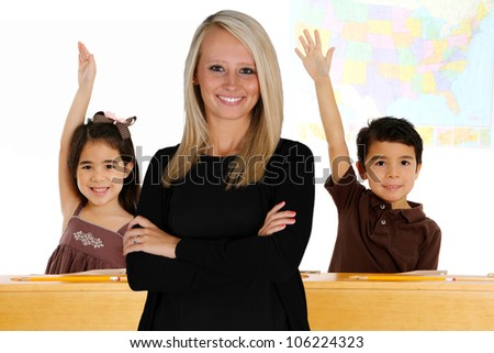 Teacher with her students in a classroom - stock photo