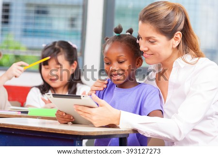 Teacher with multi ethnic classroom. Happiness and integration concept. - stock photo