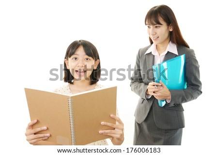Teacher with teen girl studying. - stock photo