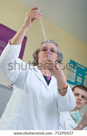 teachers and students of medicine in the laboratory - stock photo