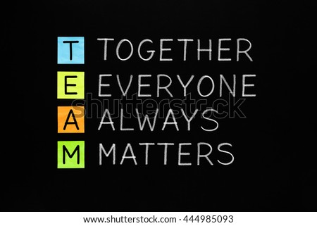 TEAM acronym Together Everyone Always Matters handwritten with white chalk on blackboard. Teamwork concept. - stock photo