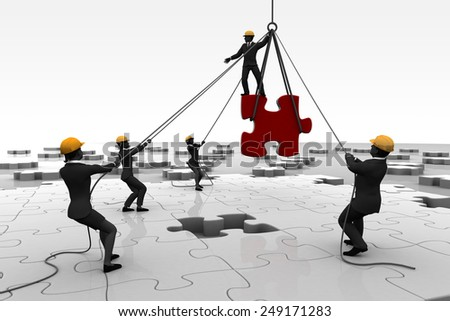 Team assembling a giant jigsaw puzzle. A team working on a giant jigsaw puzzle project on the ground. - stock photo