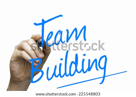 Team Building hand writing with a blue mark on a transparent board - stock photo