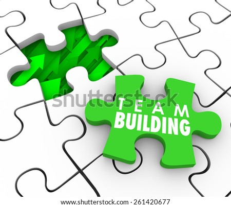 Team Building Words on a puzzle piece to fill a hole in your company, business or organization with new people or employees who will work together to achieve a common goal - stock photo