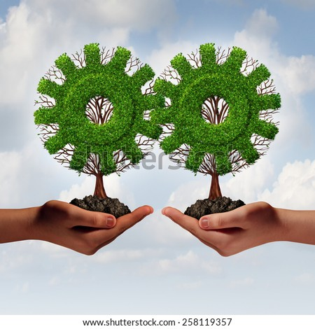Team business strategy concept as two hands holding connected trees shaped as a gear or cog as a growing financial partnership united together for corporate growth and teamwork. - stock photo