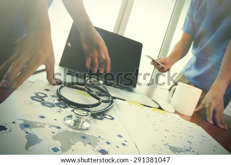 team doctor working with laptop computer in medical workspace office and medical network media diagram as concept - stock photo