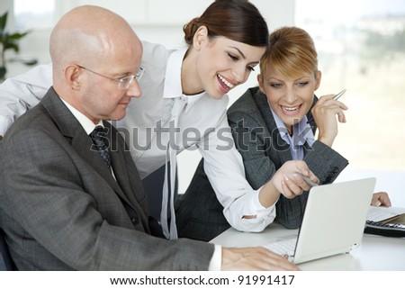 team having fun discussing work - stock photo