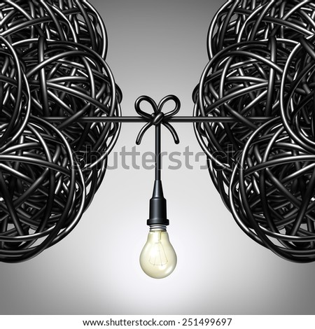Team ideas and collaboration concept as two groups of tangled electric cord or wire with a light bulb connection tied together between the partners as a teamwork metaphor for success. - stock photo