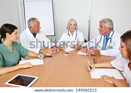 Team meeting of some doctors in a hospital - stock photo