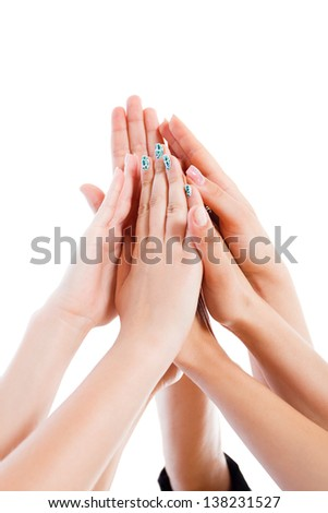 Team members' hands together as symbol of power and unity isolated on white. - stock photo