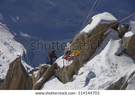 Team mountain rescue - stock photo
