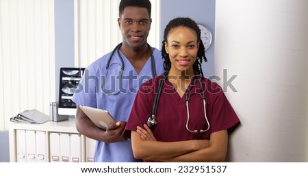 Team of African American medical doctors standing together in hospital - stock photo