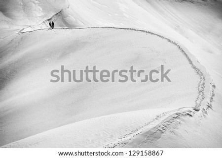 Team of alpinists climbing a mountain - stock photo
