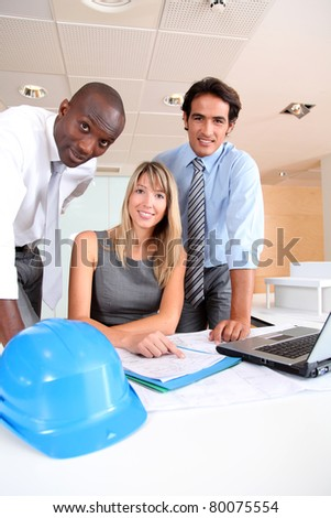 Team of architects working in the office - stock photo