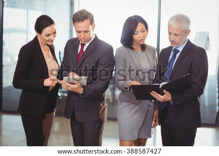 Team of business people interacting in the office - stock photo